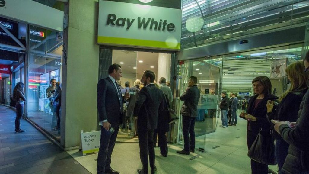 Standing room only as the crowd of buyers spills into the street at the Ray White Double Bay auction on Monday night. Photo: Michele Mossop