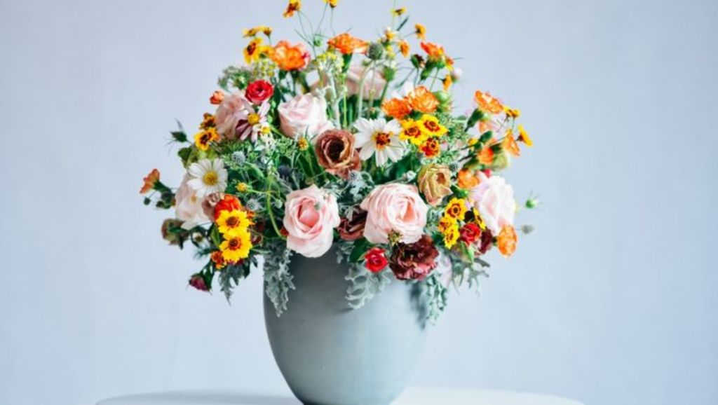 Fresh flowers are the perfect way of showing your grown-up hosting abilities. Photo: Stocksy