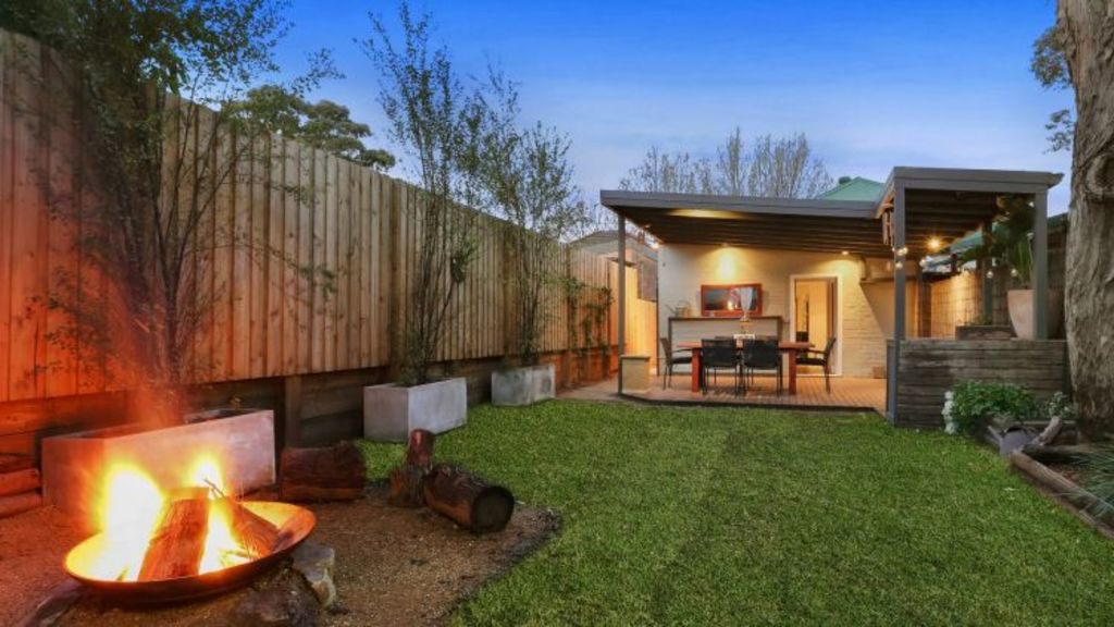 1178 Botany Road, Botany: A covered deck gives way to a level lawn with a feature fire pit. Photo: Supplied
