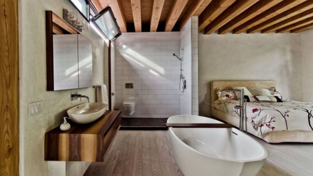Elaborate, contemporary bathrooms like this beauty, designed by Gervais Fortin, are tricky to sell to everyday buyers. Photo: Alexandre Parent