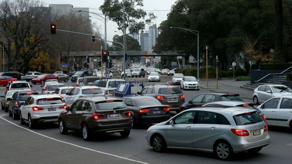 A lack of investment in transport infrastructure has seen traffic bottlenecks, like this one at St Kilda Road and Kings Way, increase. Photo: Pat Scala