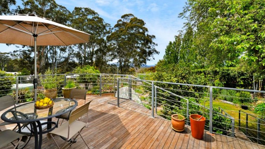 The timber deck at 26 Rosenthal Avenue, Bundanoon, offers elevated views.