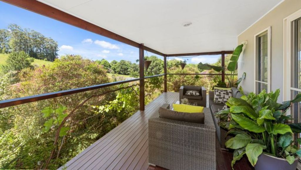 4 Hilliana Close, Bellingen.  The spacious deck hugs three sides of the home.