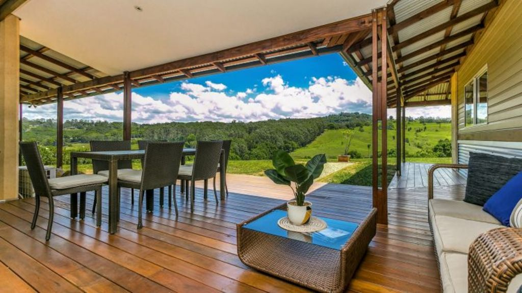 The large deck at 9/213 Coorabell Road, Coorabell, looks out over the rolling NSW countryside.