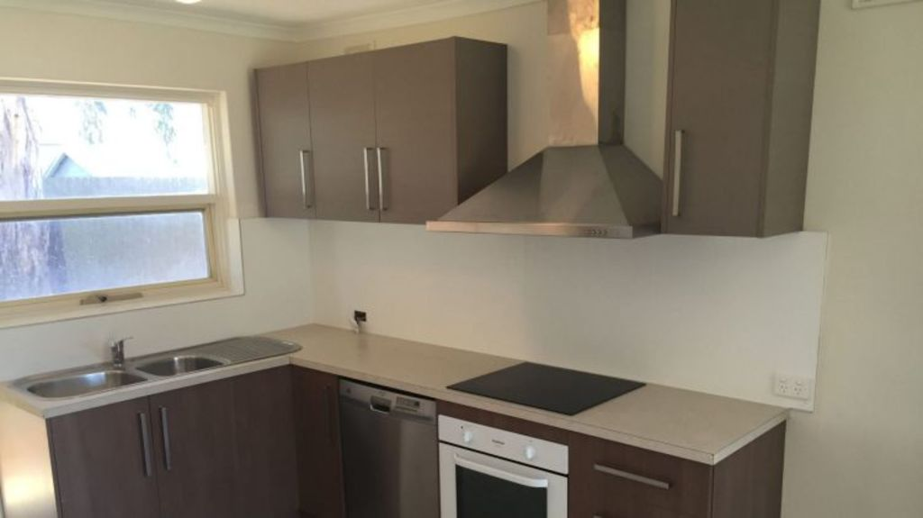 After: The kitchen in the Salisbury house needed a quick renovation, including new floating laminate floorboards, new kitchen cabinetry and appliances, new splashback and sink to a total cost of $3000.