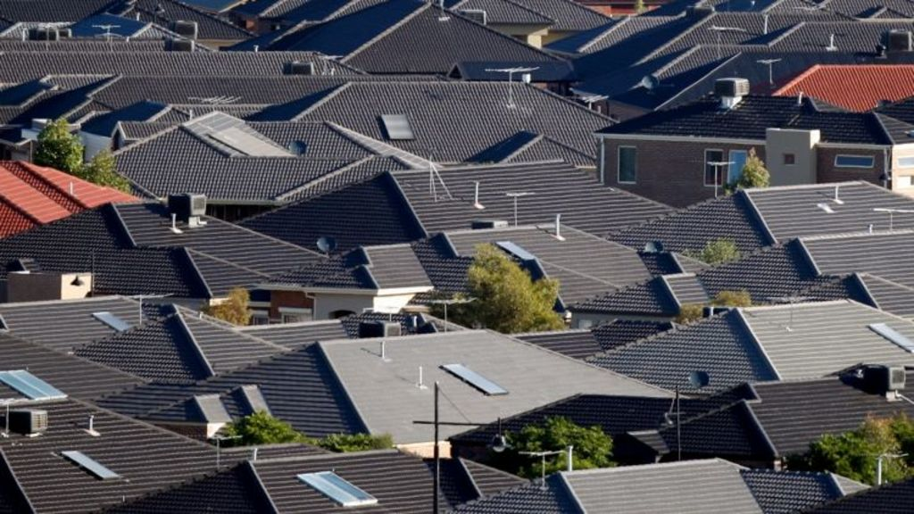 Many of the houses on Melbourne's fringe have bad shading and black roofs, which act as solar collectors. Photo: Paul Rovere