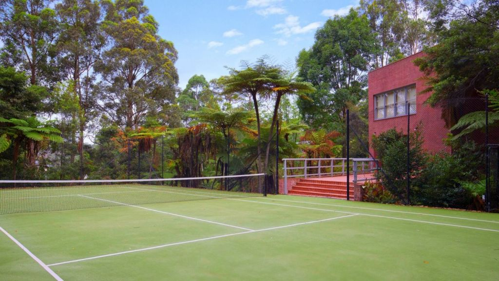 The secluded grounds include a private tennis court. Photo: Supplied