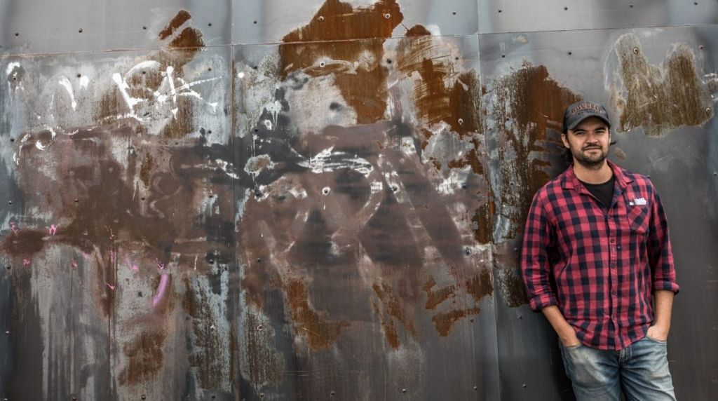 Roshan Nijar, co-owner of Up In Smoke, also copped anti-hipster graffiti in January. Photo: Jason South