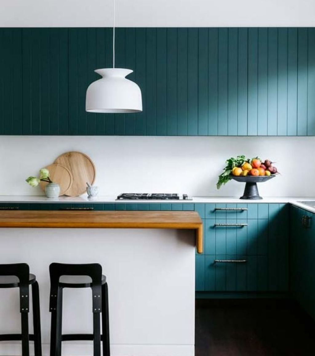 This Arent&Pyke kitchen brings warmth and colour to the home Photo: Supplied