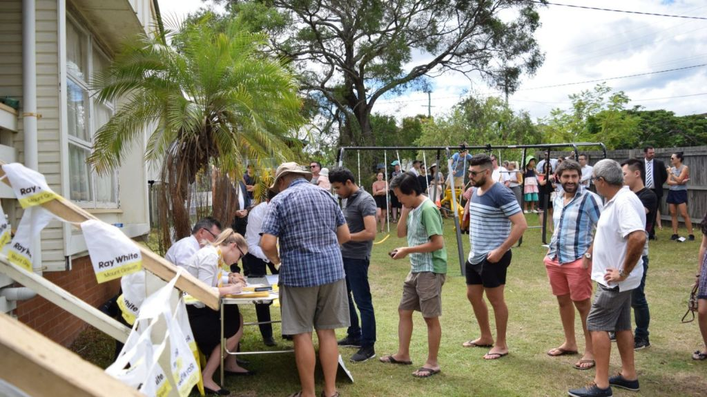 Some of the 39 bidders lining up to register for bidding at 19 Hillgrove Street, Upper Mount Gravatt, earlier in March. Photo: Jim Malo