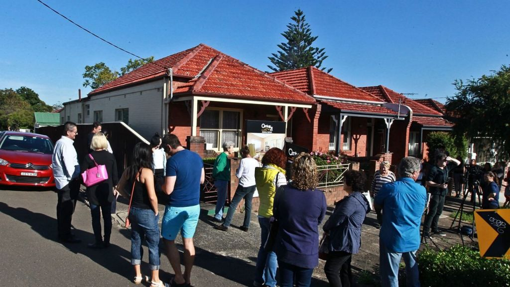 About 50 people gathered to watch the auction of 42 Elswick Street, Leichhardt. Photo: Ben Rushton