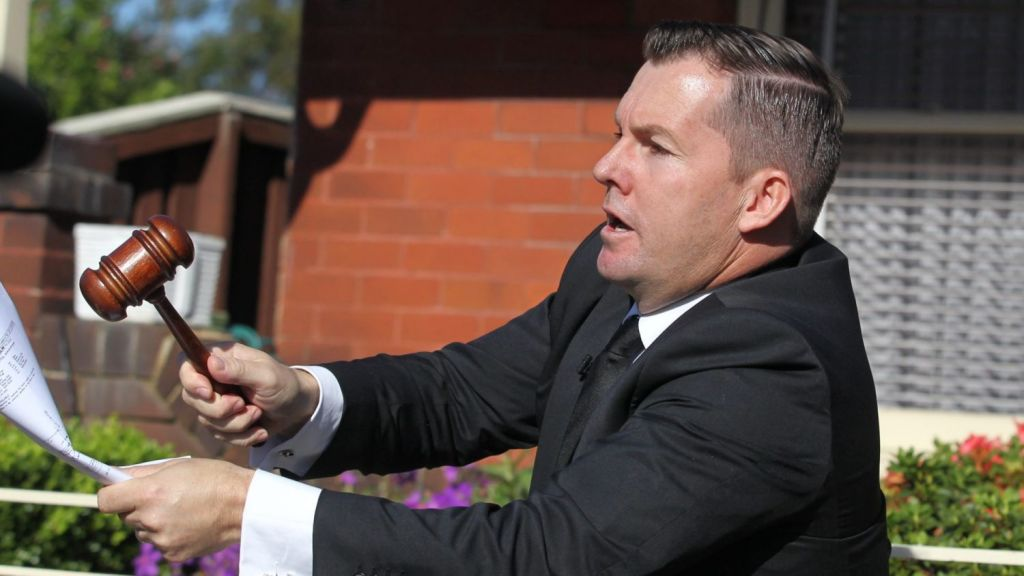 Auctioneer Will Hampson of My Auctioneer sells the property under the hammer. Photo: Ben Rushton