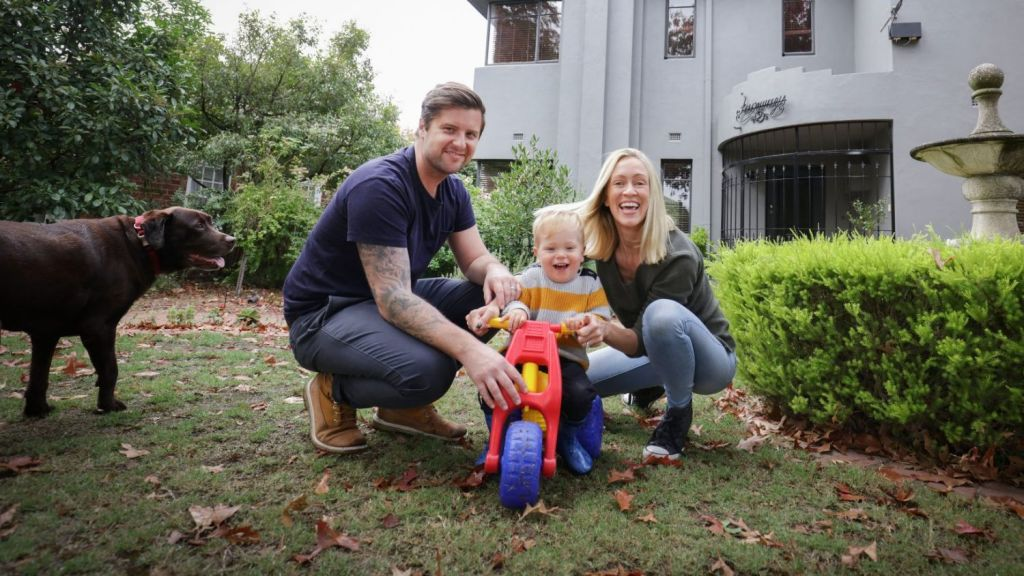 Amy Carlson and Jamie Hodgson with their son Olli at their Malvern East home. Photo: Nicole Cleary