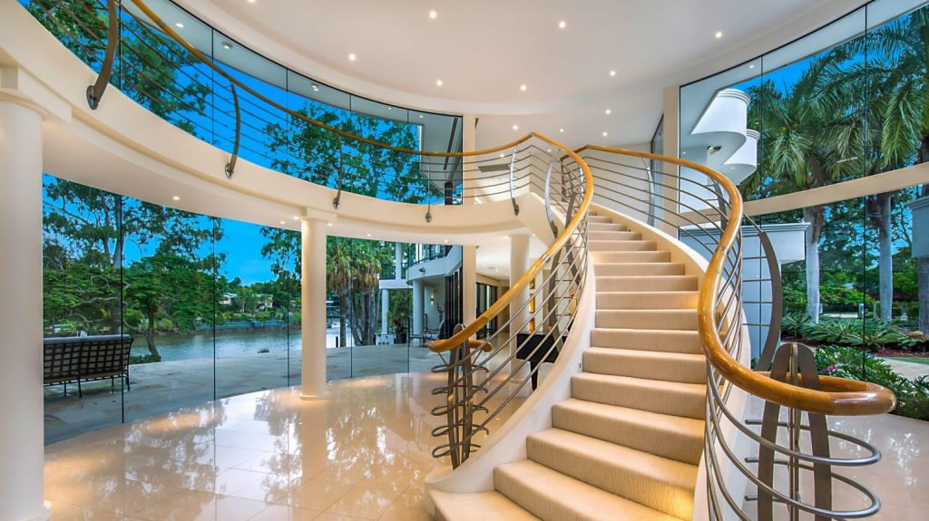 The grand foyer and sweeping staircase are indicative of the scale of the property. Photo: Supplied