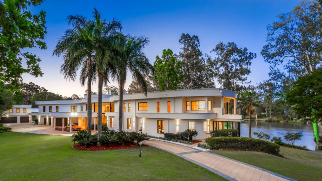 A pillared, gated driveway through sweeping lawns leads to the house. Photo: Supplied