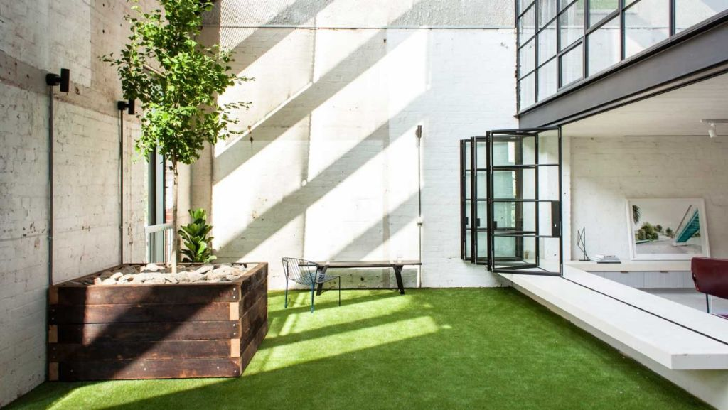 The Fitzroy industrial conversion by Architects EAT shows how loft gardens encourage light into a home and extend the living space by adding an outdoor room. Photo: James Coombe