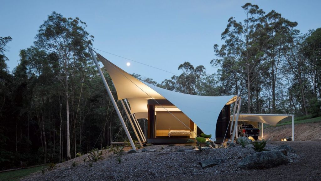 The tent house, which sits beneath dramatic sail-like structures at the edge of dense rainforest near Doonan, has earned Sparks Architects the Regional Project of the Year award at the 2017 Sunshine Coast Regional Architecture Awards. Photo: Supplied