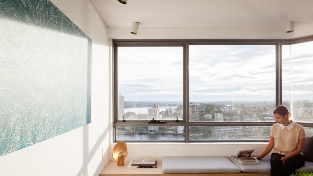 The Milsons Point apartment by Brad Swartz Architects. A window seat takes advantage of harbour views. Photo: Katherine Lu