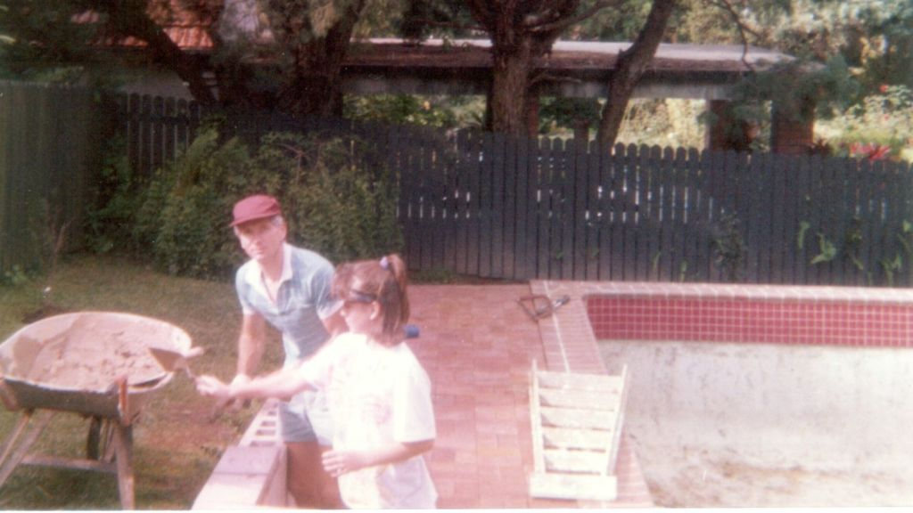 John Reuschle and Amanda Wecker renovating their home in 1989. The pool has since been filled in. Photo: Supplied