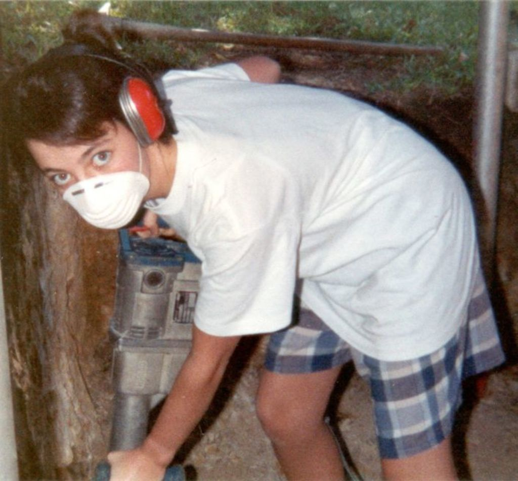Mrs Wecker helping out her father under the house. The picture was taken in 1990. Photo: Supplied