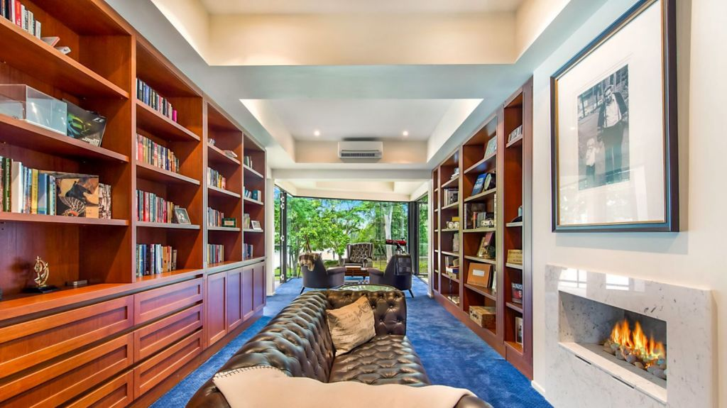Somewhere in the plush library of this Fig Tree Pocket house is a concealed door ...