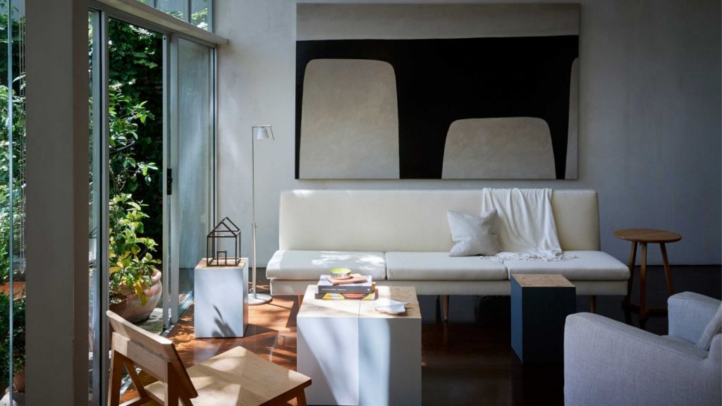 Faithful renditions of the sofa, and cork-top dining table, designed by Robin Boyd. Photo: Supplied