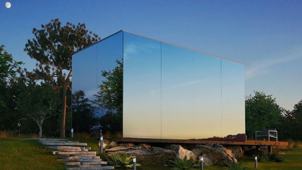 Mirrored on three sides, this tiny house blends into the landscape so at times it is literally invisible. Photo: Anton Toomere