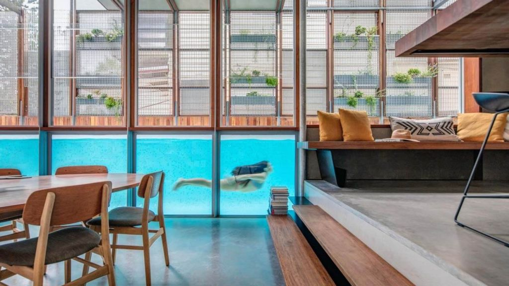A pool runs through the middle of The Living Screen House. Photo: Murray Fredericks.