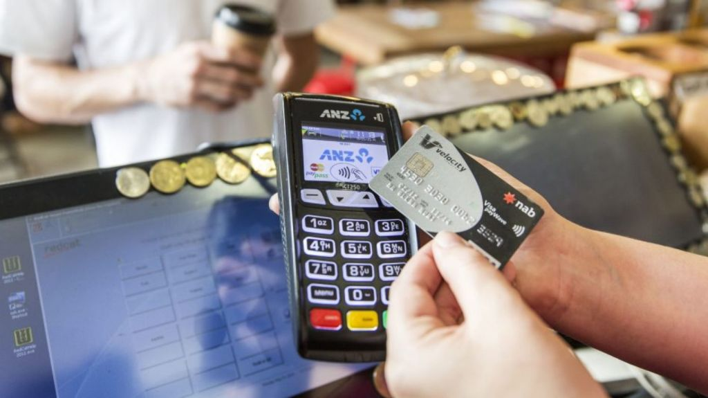 Evidence suggests people spend more money when they don't to use cash. Photo: Glenn Hunt