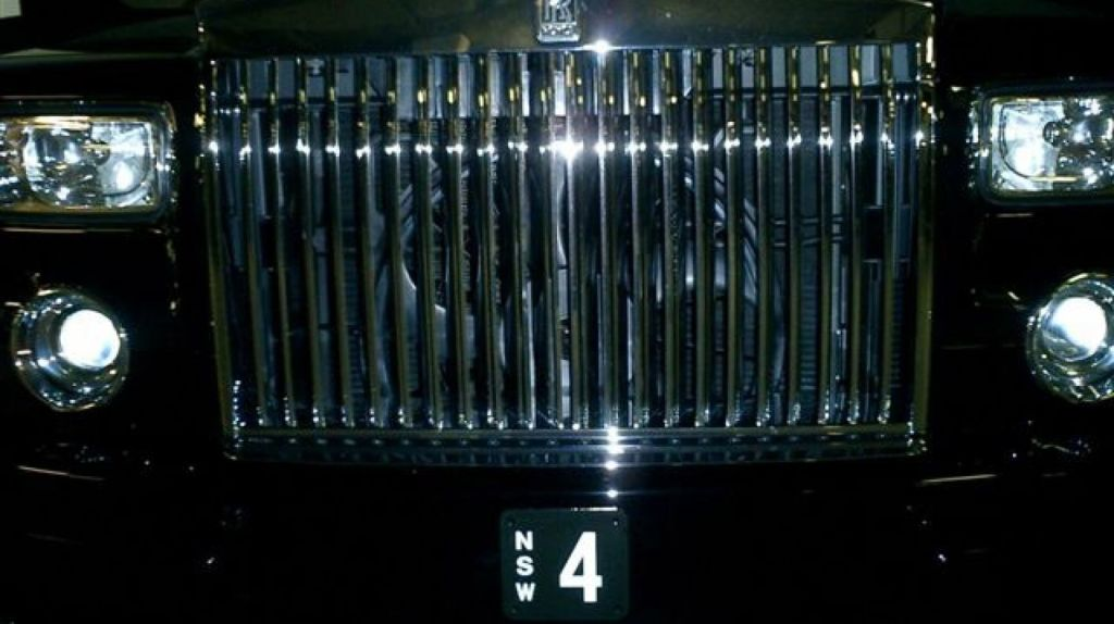 The $1.2 million No.4 licence plate on the Rolls-Royce of Aussie John Symond. Photo: Supplied