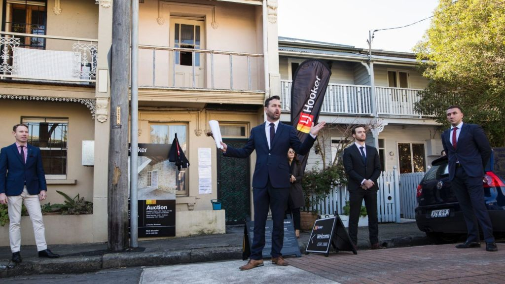 Auctioneer Ben Mitchell at the auction of 12 Clara Street in Erskineville which sold for $1,085,000. Photo: Dominic Lorrimer