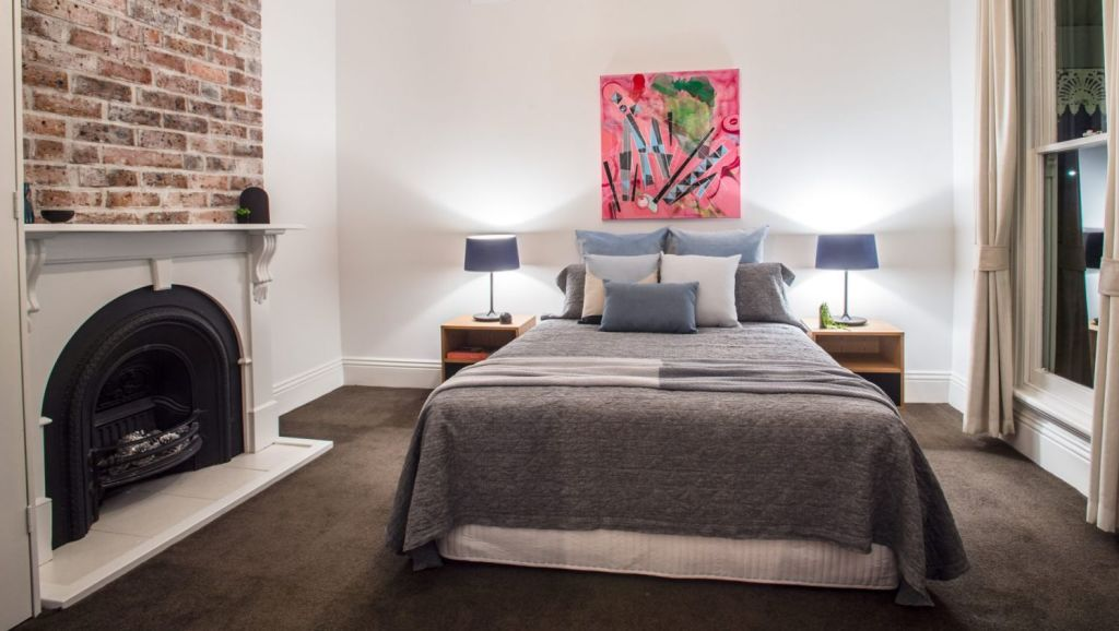 Bedrooms at 34 Durrant Street, Brighton have high ceilings and the romantic touch of open fireplaces. Photo: SDP Media