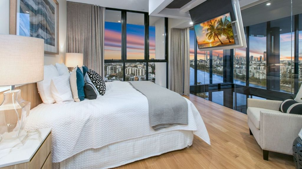 The master bedroom overlooks the void, and the view. Photo: Supplied