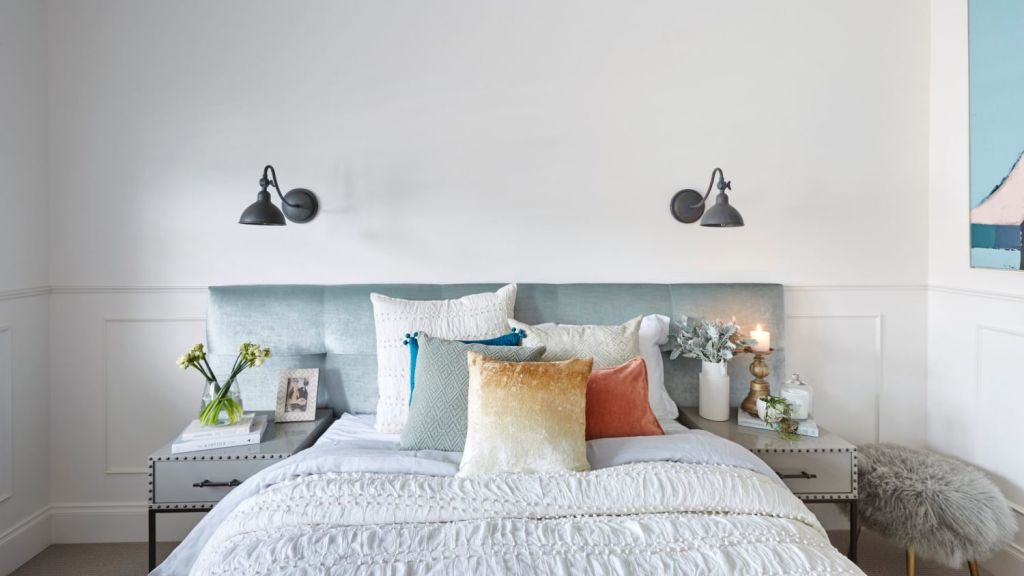 The combinations really are endless so don't be scared of your pillows. Josh and Elyse's room. Photo: David Cook