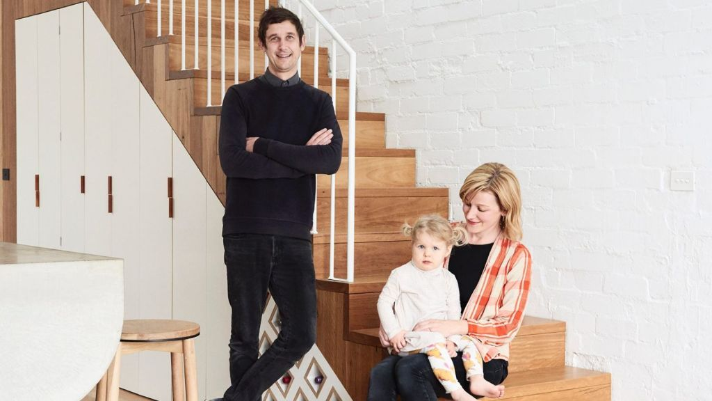 Dan Gayfer, Leah Hyland and their adorable two-year-old daughter Clementine in their Fitzroy North home. Photo: Eve Wilson