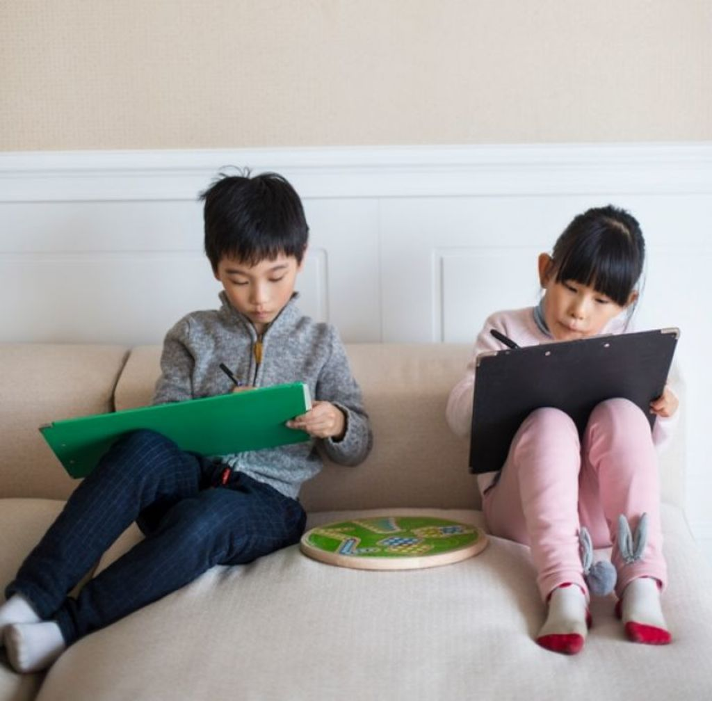When making a decision about room sharing, parents need to consider the developmental stages of their children and their individual personalities. Photo: Stocksy