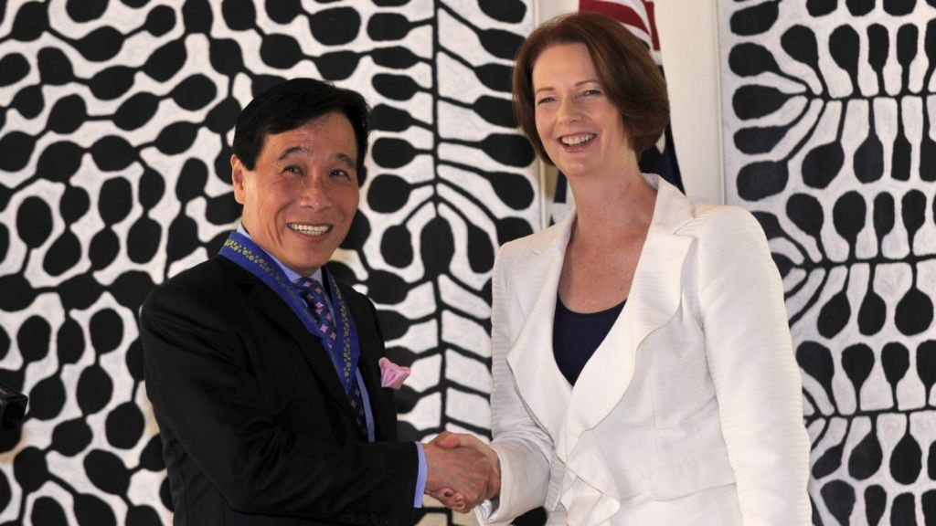 Chio Kiat Ow with former prime minister Julia Gillard in Singapore in 2012. Photo: Supplied