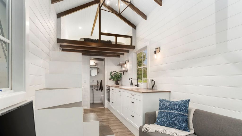 'The Hillside' features a loft bedroom and pitched roof. Photo: Tiny Homes Australia