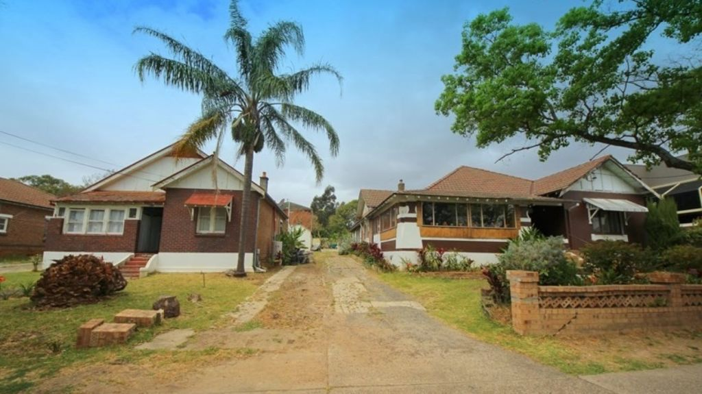 Two Lakemba homes - 20 and 21 The Boulevard - with zoning for high-density development, passed in at auction at $4.75 million. Photo: Supplied.