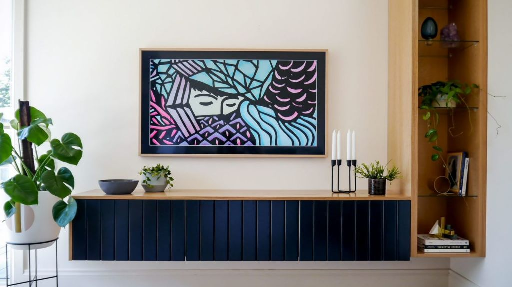 Michelle Hart of Bask Interiors was asked to design and style the room around the client's television choice, the Samsung The Frame TV. Photo: Photo: Kate Hansen - The Room Illuminated. Styling: Michelle Hart and Zarina Fernandez