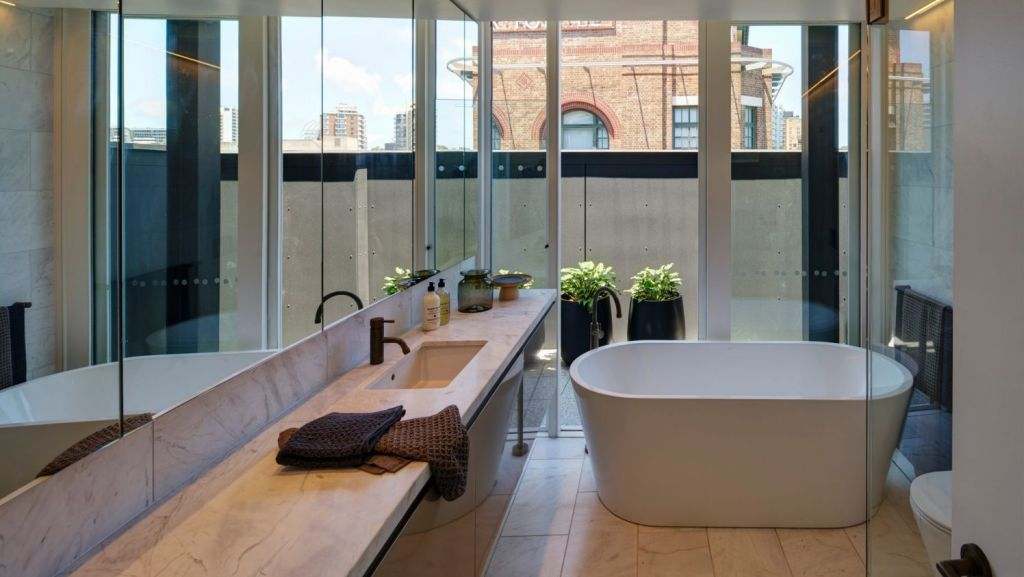 The bathroom inside one of the loft-style penthouses in the newly-renovated Griffiths Tea Building. Photo: Michael Nicholson