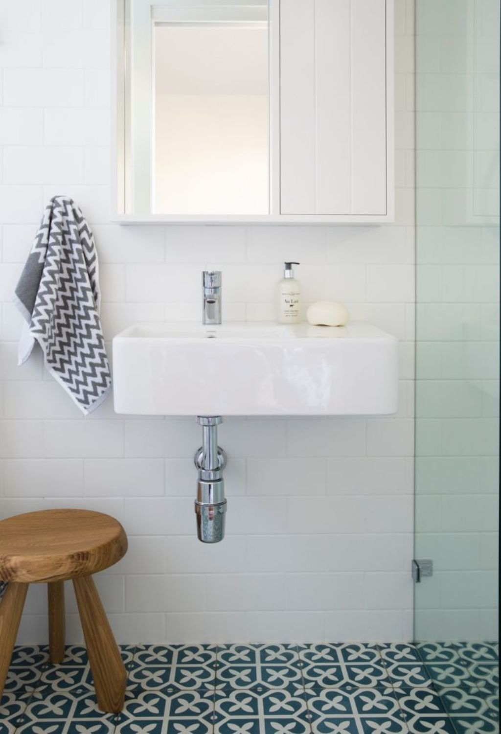 Painting tiles is a great alternative to ripping them out. Photo: Studio Gorman