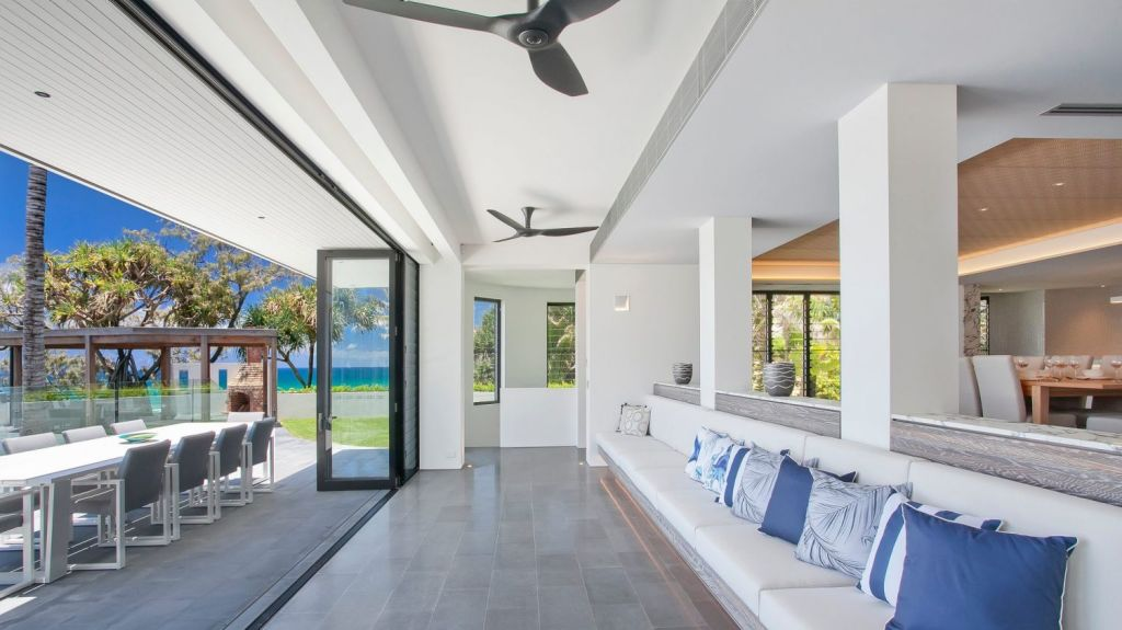 The house features grandiose living areas, both inside and out. Photo: Supplied