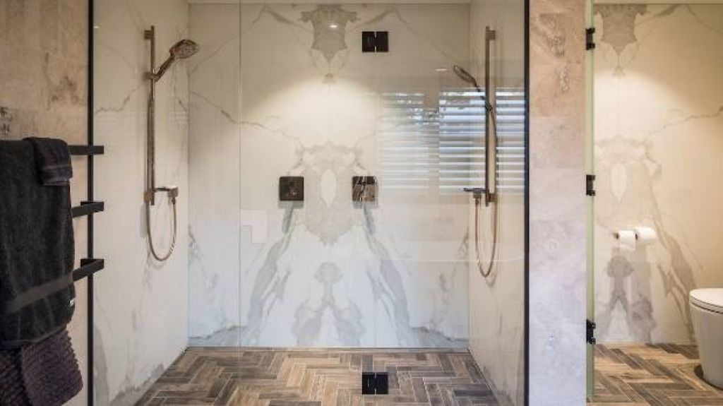 Showers over baths are not practical for the elderly. A free-standing shower is a better option. Photo: TIDA