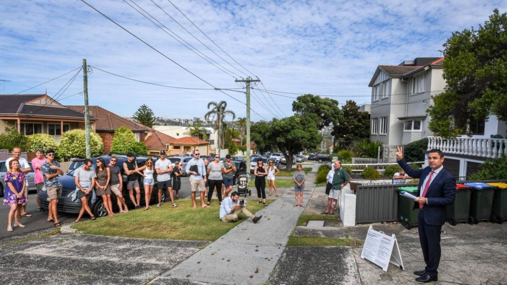About 40 people turned out for the auction of 9 O'Donnell Street, one of 942 properties scheduled to go under the hammer on Saturday. Photo: Peter Rae.