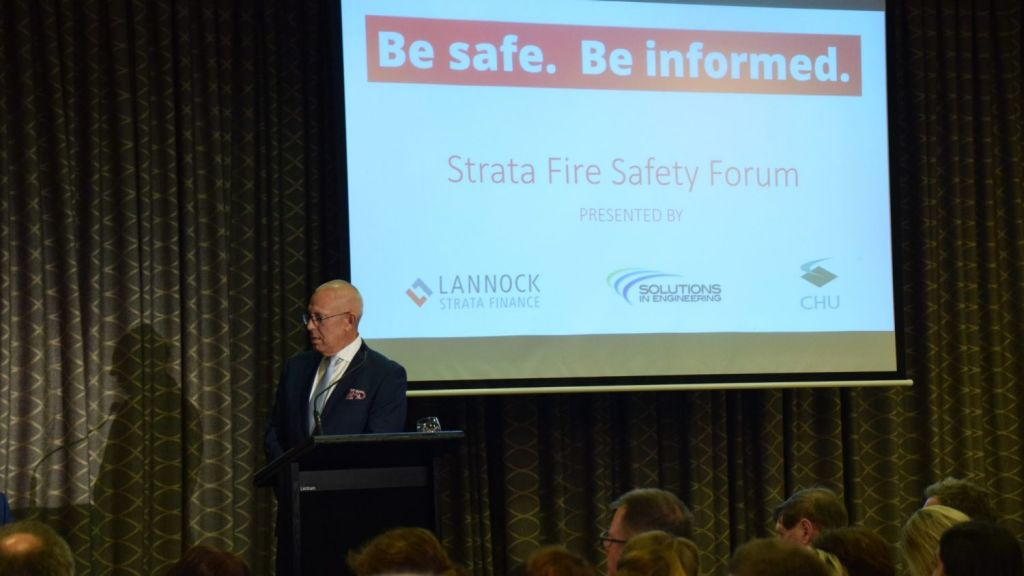 Solutions in Engineering chief executive Ross Daley hosting an industry forum in Brisbane to inform strata managers of their options in dealing with flammable cladding. Photo: Jim Malo