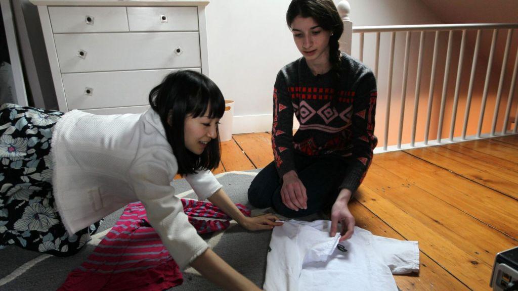 Marie Kondo gives a folding lesson to a young fan. Photo: Boston Globe