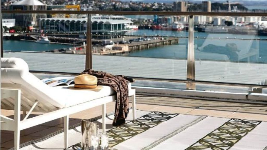 If your balcony is positioned to receive sun in the middle of the day, set it up as a sun lounging area. Photo: Jane Ussher