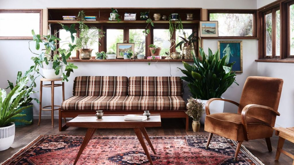 The wonderfully eclectic living room of Jenna Holmes, aka Plant Mama. Photo: Eve Wilson