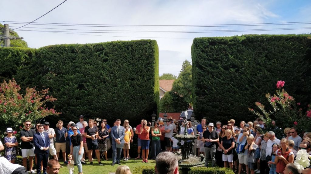 A huge crowd gathered to watch the house sell under the hammer. Photo: Allison Worrall